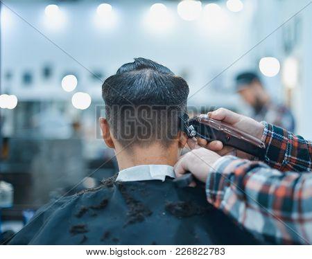 Men's Haircut In Barbershop. Barber Shears Clippers.
