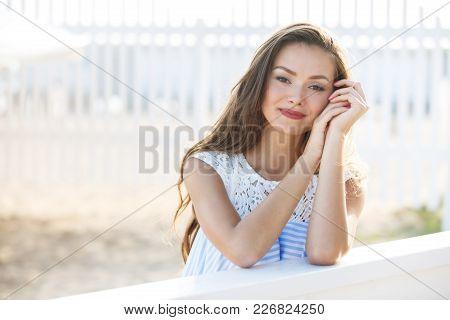 Young Smiling Woman Outdoors Portrait. Close Portrait.