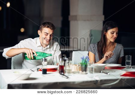 Smiling Woman On A Date In A Restaurant,having A Conversation Over A Meal In Hotel.cheerful Female C