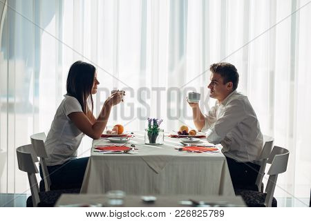 Happy Couple At Restaurant Eating Lunch.talking Over Meal.hotel Full Board,all Inclusive Stay.travel
