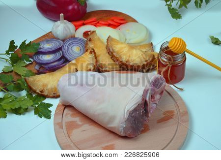 Raw Pork Knuckle With Onion, Carrot, Garlic, Cloves, Honey, Soy Sauce On Wood