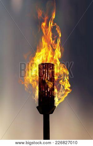 burning torch at night, close up