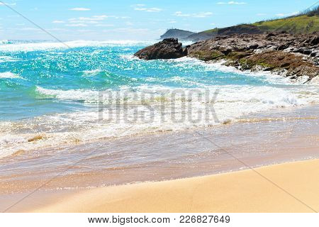 The Beach Near The Rocks In The Wave Of  Ocean