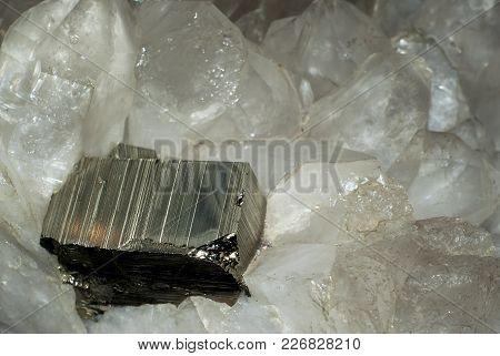 Large Rectangular Pyrite Crystal Among Quartz Crystals Closeup