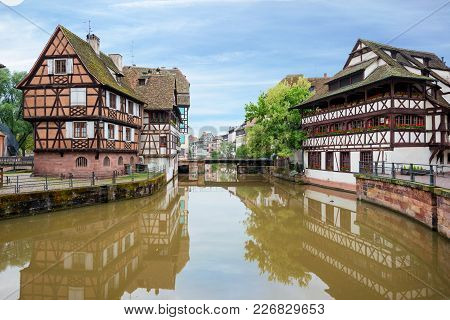 Quaint Timbered Houses Of Petite France In Strasbourg, France. Franch Traditional Houses At Strasbou