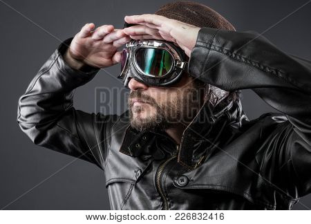 freedom, recreation of the Second World War, old airplane pilot with brown leather jacket, cap of avidor and large glasses