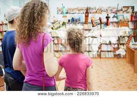 Mother with two children visiting a bookcase with a map and world attractions, collage