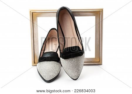 Women Shoes And Wooden Frame Isolated On White Background