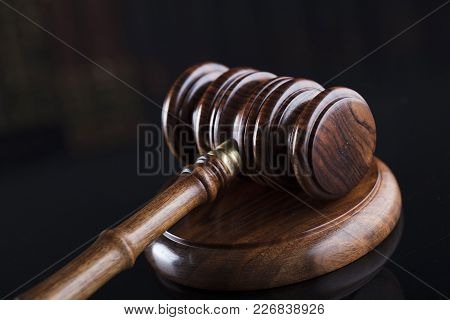 Law  Theme. Gavel On Book Background And Glass Table.