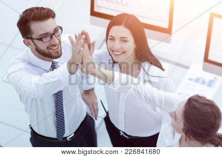 successful business team giving each other a high five .