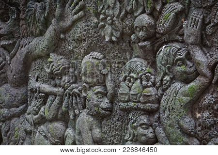 Wall With Reliefs And Moss In Bali Indonesia