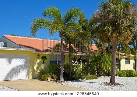 Beautiful Florida Ranch Style House With Palms Trees And Landscaping
