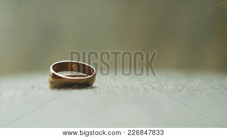 One Gold Wedding Ring Rolled To Another. Video. Wedding Rings. Two Well Used Golden Wedding Rings On