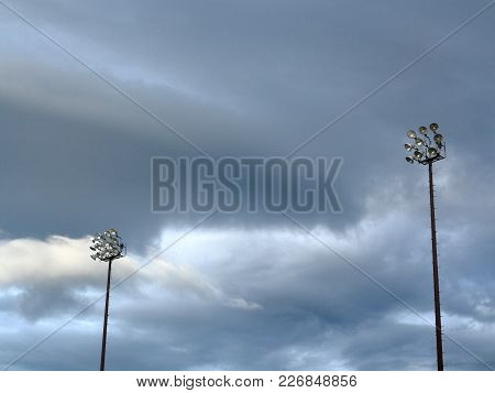 Light Towers - Outdoor Sports Lighting Towers And Cloudy Blue Sky.