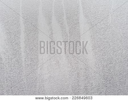 Abstract Grunge Texture Of A White City Wall With Stripes And Streaks Of Gray Mud Drop.