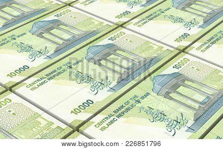 Iranian rials bills stacked background. 3D illustration.