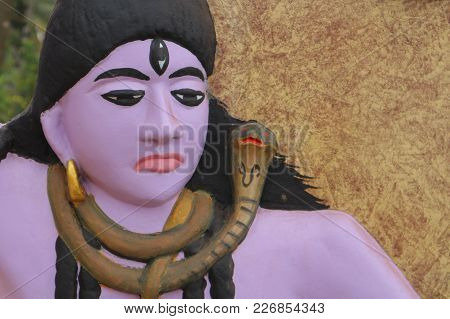 The Dissatisfied Lord Shiva Is A Sculpture On The Wall In India.