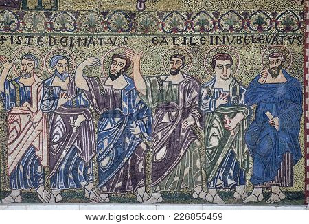 LUCCA, ITALY - JUNE 03: Apostles mosaic on the facade on Romanesque Basilica of San Frediano, Lucca, Tuscany, Italy on June 03, 2017.