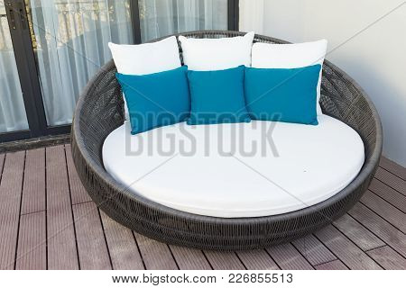 Relaxing Rattan Chairs With Pillows In Hotel Balcony