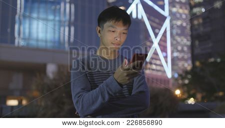 Man using mobile phone at outdoor