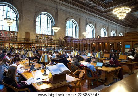 NEW YORK, USA - MARCH 24, 2017: Student into the national public librairy in New york city with nearly 53 million items, the NY Public Library is the second largest public library in the United States