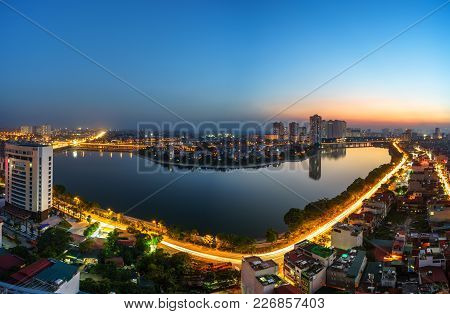 Aerial View Of Hanoi Skyline Cityscape At Twilight Period. Linh Dam Lake, South Of Hanoi Capital