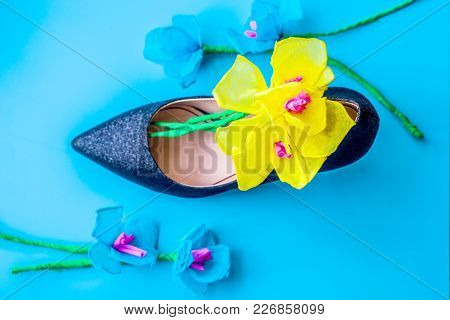 Women Day Concept. Elegant Floral Composition In Black Lady High Heel Shoe On Blue Background