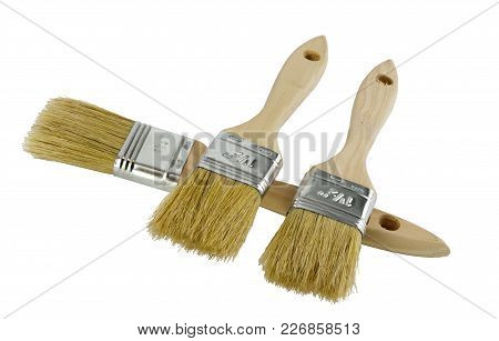 Wooden Handled Paint Brushes Lying On The Side