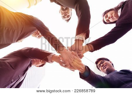 Group Of Business People Joining Hands.team Work Concept.