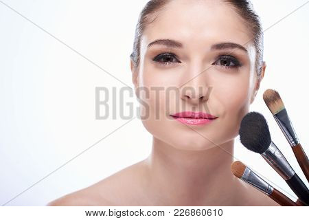 Headshot Of Young Pretty Woman With Pink Lips Looking At Camera On White Background With Make-up Bru