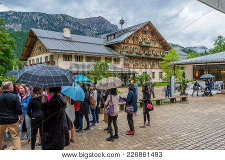 Editorial: LINDERHOF, BAVARIA, GERMANY, June 6, 2017 - Many tourists visit Linderhof Palace even in bad weather.