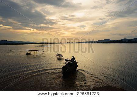 Vietnam Landscape. Lake With Elephant Walking At Sunset In Vietnam