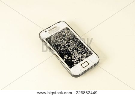 Mobile Modern Touchscreen Smartphone With Broken Screen Isolated On White Background