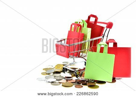 Shopping Bags  In Cart On White Background. The Inside Shopping Cart Has Red And Green Shopping Bags