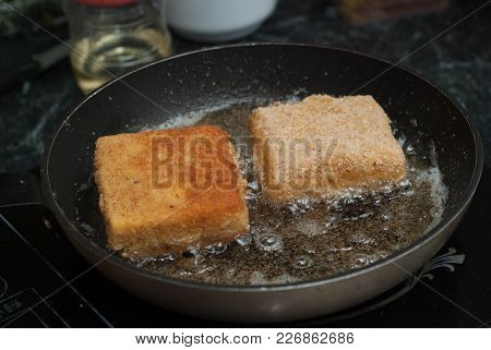 Frying Square Bread For Sandwich. Food Preparing Pane In Pan With Oil.