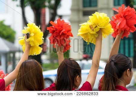 Cheerleader Hands Cheering With Pom Poms Closeup