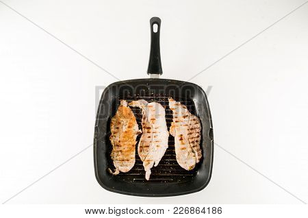 White Meat In A Pan Fry Making Food