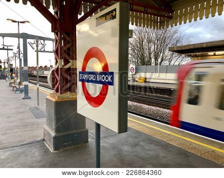 LONDON - FEBRUARY 12, 2018: A Piccadilly Line train arrives into Stamford Brook Underground Station in Chiswick, West London, UK.