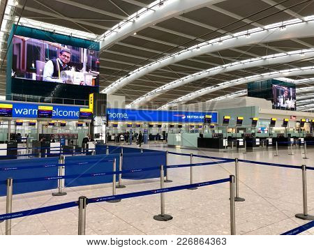 HEATHROW AIRPORT, LONDON - FEBRUARY 14, 2018: British Airways checkin and baggage drop desks on the landslide departures level in Terminal 5, Heathrow Airport, London, UK.