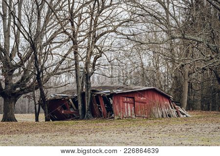 Abandoned red barn in winter