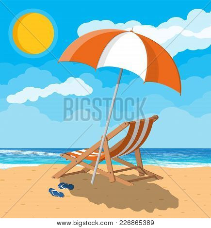 Landscape Of Wooden Chaise Lounge, Umbrella, Flip Flops On Beach. Sun With Reflection In Water And C