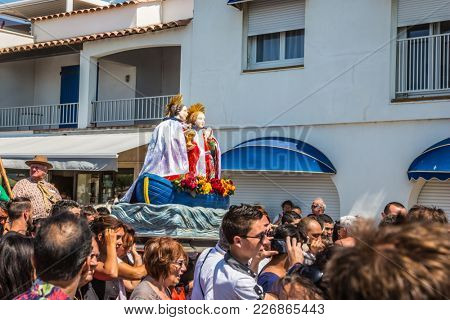 Saintes-Maries-de-la-Mer, France - May 25, 2015. The crowd is accompanied by two statues Holy Maries. Religious feast in honor of the Holy Maries in Provence. The concept of ethnographic tourism