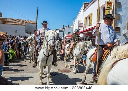 Sent-Mari-de-la-Mer, Provence, France - May 25, 2015. World Festival of Gypsies. The concept of ethnographic tourism. Convoy on white horses