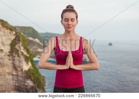 Woman Hands In Namaste Prayer Mudra. Symbolic Or Ritual Gesture In Hinduism And Buddhism. Cliff And