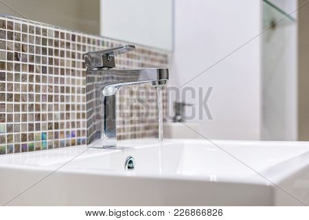 Modern Styled Chrome Faucet (tap) And Sink (basin).