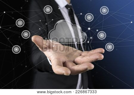 Cloud In The Hand Of Businessman. The Concept Of Cloud Service.
