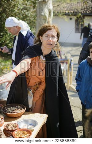 Veliko Tarnovo,bulgaria, April 04 2015, Woman With Vintage Clothes Cook Medieval Meal In The Medieva