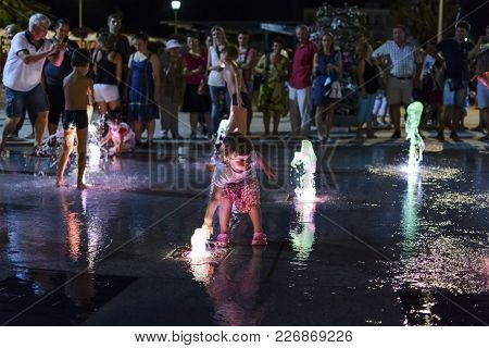 Varna, Bulgaria - August 16, 2015: Young Girl Playing With Fountain Water During The Varna Anniversa