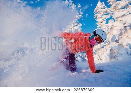Action Snapshot Of Snowboarder In Motion. Freeride Snowboarding In Ski Resort