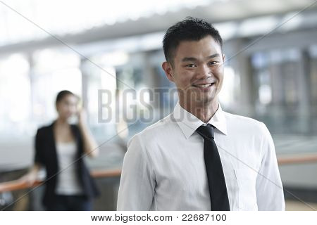 Businessman With Colleague In The Background